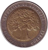Цветущее дерево гуакари. Монета 500 песо. 2006 год, Колумбия. Из обращения.
