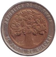 Цветущее дерево гуакари. Монета 500 песо. 1994 год, Колумбия.