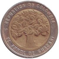 Цветущее дерево гуакари. Монета 500 песо. 1995 год, Колумбия.