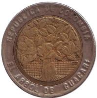 Цветущее дерево гуакари. Монета 500 песо. 2007 год, Колумбия.